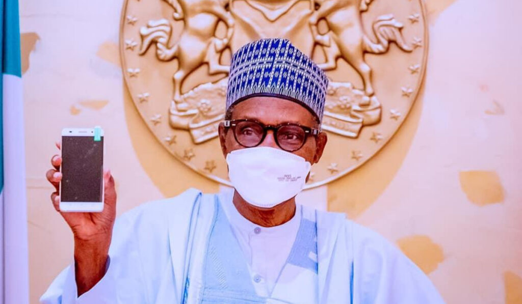President Buhari unveils ITF Mobile phone.